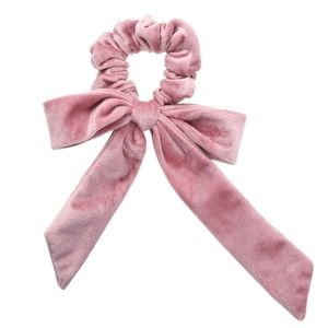 Pink velvet scrunchie with a bow